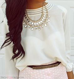 Sheer blouse with statement necklace