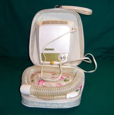 ..hair dryer w/plastic bonnet...not such a sweet memory ~ can you believe we used these???