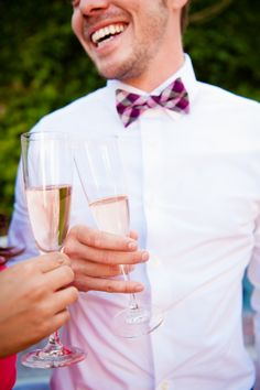 Casual bow tie groomsmen look with simple white shirt. ---> http://www.weddingchicks.com/2014/06/04/sonoma-summer-wedding-by-catherine-hall-studios/