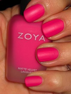 Hot pink nails with a matte finish.