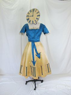 Holy Moly!  Look at this vintage clock costume!  Isn't it amazing?!  This would be an amazing Halloween costume with a great story to tell.  I love the clock hat.  For sale on Etsy by Tovas Vintage for $275.00.  Size is a S/M.