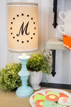 A monogram is a lovely way to put a lampshade in a  personalized light. Learn how we customized this lampshade within minutes, here!