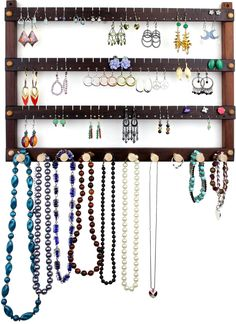 Jewelry Holder - Earring Holder, Hanging, Peruvian Walnut, Wood. Holds 72 pairs plus 10 peg Necklace Holder.  Wall Mounted Jewelry Organizer. $39.99, via Etsy.