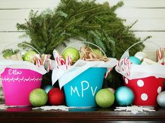 Give your holiday decorations a playful twist by swapping out traditional Christmas stockings for metal pails painted with fun, bright colors.