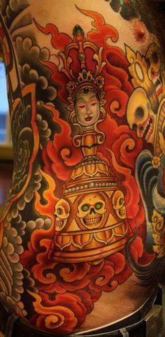 skull and tibetan prayer tool tattoo by Cory Norris of Grass Valley, CA