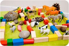 A simple imaginative play set up - farm play. Plus a farm song to sing using the animals as props.