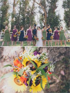 green, navy and purple bridesmaid dresses with bright sunflower bouquet http://www.weddingchicks.com/2013/09/25/rustic-summer-wedding/