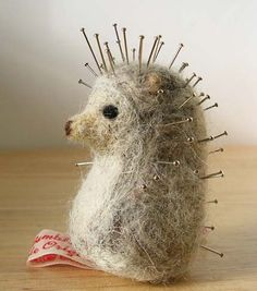 Adorable pincushion! By Ruth Rivers on her Etsy shop MissBumbles.