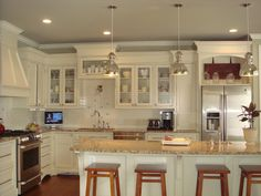 Want to repaint the cabinets white/cream, upgrade to granite or quartz countertops