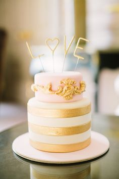 gold and pink wedding cake, photo by Mustard Seed Photography http://ruffledblog.com/romantic-paris-elopement #cakes #weddingcake #pinkandgold