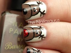 Reindeer Nail Art http://www.ivillage.com/holiday-nail-art-designs-snowflakes-candycanes/5-a-548722
