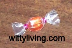 SWAPS Candy... Pony bead, mini hair elastics (the small ones that are like retainer or braces rubber bands), clear  plastic wrap/cellophane/2 inch square of sandwich bag. DIRECTIONS: Roll the pony bead in the plastic. Tie off each end with a rubber band. Attach pin.