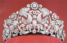"""The Braganza Tiara of Sweden. Composed of arabesques, flowers & leaves depicted in diamonds & mounted in gold & silver, this tiara measures 12.5 cm (just under 5 inches) tall. It belonged to Empress Amélie of Brazil (hence the """"Brazilian""""), whose husband Pedro I also used the title Duke of Braganza (hence the """"Braganza""""). Originally of French craftsmanship from the 18th century, Amélie had the design altered in 1820 to the form the tiara currently holds."""