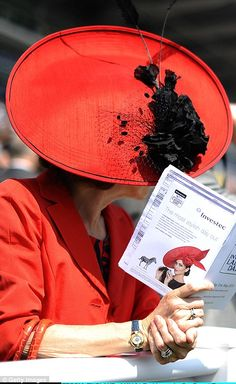 Another racegoer wore a wide-brimmed red number