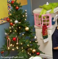 """A wise preschool teacher once told me that she put a Christmas tree in the dramatic play center for the kids to decorate and undecorate to their hearts content since the Christmas tree at home is usually """"hands off."""" The kids love this activity!"""