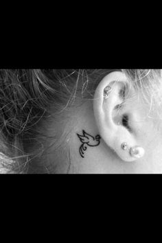Cool behind the ear tattoo