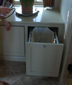 built-in laundry cabinets in the bathroom. Christa you could have this built in to your bathroom linen closet.