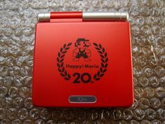 Game Boy Advance SP (iQue Mario 20th Anniversary edition; 2005)