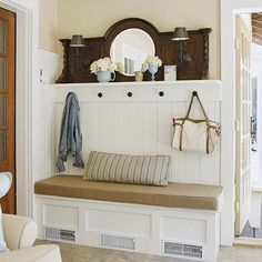 Clever coat rack & bench with mirror from antique sideboard, which has been retro-fitted with electric sconces.