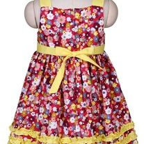 Fun and flowery, your summer girl will look so lovely in this dress. Sweet smocked bodice is accented with yellow bow tie on the right top shoulder and  yellow ruffle trim on the skirt.    100% cotton.   Machine washable. ruffl trim, bow tie, yellow ruffl, summer girl