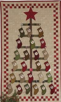 Stockings hung on quilt with printed tags. Advent calendar... adorable!