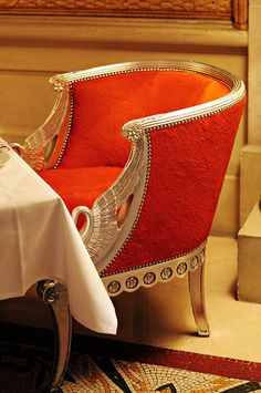 oh god. now that is a chair. fiery tangerine and a light gold... and that incredible detailing...