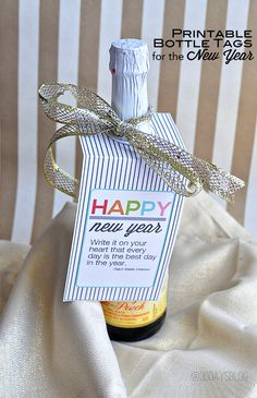 Printable New Year's Eve Bottle Tags. Print out these tags and add to a bottle for the perfect and simple new year's gift.