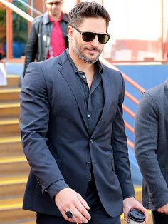 Hunky dude Joe Manganiello looked oh-so-sleek in a navy pinstripe suit topped off with aviator-inspired sunnies with a keyhole bridge!