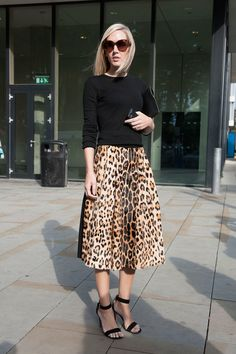 Jane Keltner de Valle pared down a notice-me leopard-print skirt with a black knit.