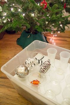 Tips And Tricks For Storing Holiday Decor: Store ornaments, Christmas lights, wreaths, wrapping paper, and more with these simple tips!