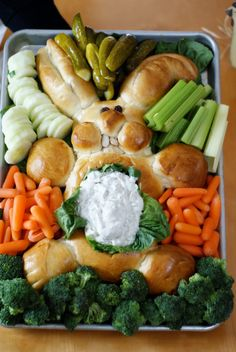 Eastere Bunny Bread-you need 2 loaves of frozen bread dough, thawed, veggie dip and veggies. Cut the dough into pieces to make all the body parts, cover, let rise. Brush with egg, bake 30 min at 350. Add 2 raisins for the eyes and sliced almonds for teeth.
