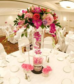 Tall centerpiece with floating light pink flowers | Photo by Christine Morden Photography