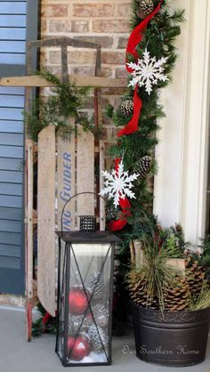 wood sled christmas decoration, christmas lanterns, christma porch, front doors, white christmas, southern homes, christmas home decor ideas, front porches, christmas porch