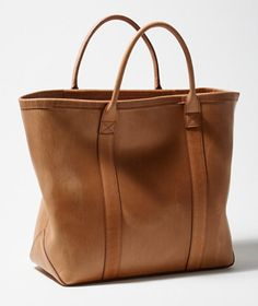 WANT. Vegetable-Tanned Leather Tote. Real story - I bought an LL Bean leather bag a few years ago and it's survived countless trips, weather and I even washed it and it looks better with age.