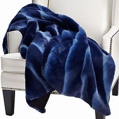 Faux in fur, but certainly not faux in warmth or softness, the sapphire Zambia Throw will take away the winter chill and replace it with a blanket of coziness.