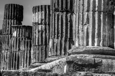 Ruined pillars in the lost city of Pompeii, Italy