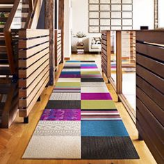 Flor Carpet Squares - mix and match.  If you get a stain, pull it up and put in a new one!