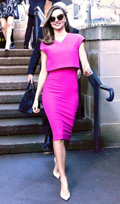 Mirada Kerr accentuates her tiny waist and long legs in this ultra flattering bright pink cropped dress