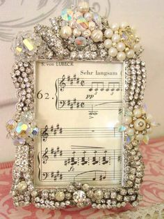 Frame of vintage jewelry; possibly a good way to use/preserve some old jewelry from my mom & grandmother first dance, wedding songs, vintag jewelri, necklac, sheet music, picture frames, families, mosaic, crafts