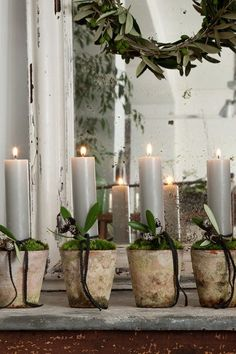 Candles in aged terra cotta pots....with moss.