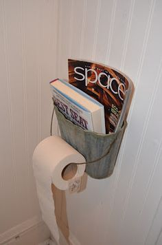 Metal basket as magazine/toilet paper holder....