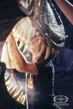 Special Effects Character Creator John Rosengrant adds final details to the animatronic T-Rex puppet on JURASSIC PARK.