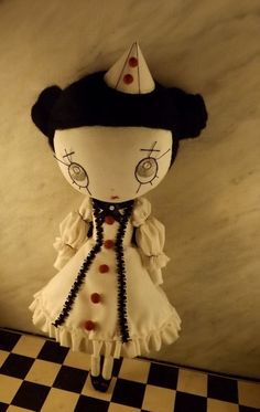 https://www.etsy.com/pt/listing/166955399/bloody-colombine-ooak-cloth-doll?ref=related-2
