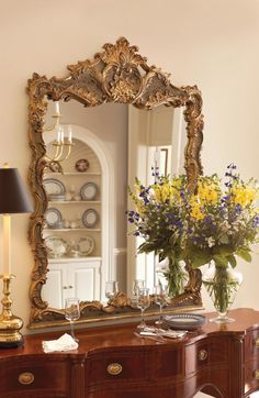 Hand carving really sets this mirror apart.  Overscaled Baroque mirror in Grecian Crackled Gold finish with rub through.    Item: EM1071   Dimensions: 45.0W x 2.0D x 62.0H inches