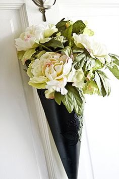 Love this front door decor--so simple and chic--possibly customize for all seasons rather than a typical wreath? front door decor, front doors, cone wreath, peoni