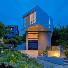 The top-floor living room of this Seattle house projects across the garden in a twisted cantilever.
