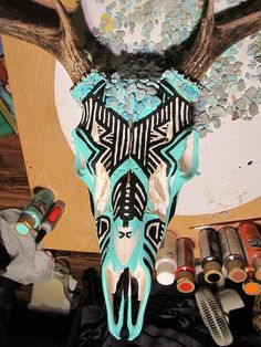 A mule deer skull I painted and added turquoise.