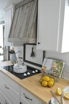 I am seriously in love with this range hood cover on Hometalk~~Bet my oh-so-clever hubby can replicate it!  ;-)