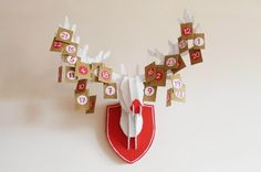 Love the idea of painting the cardboard faux trophy deer head to look