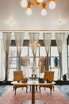 Billy Reed store in Atlanta: Full-length windows + platform + full length sheers gathered and puddled... http://TGtbT.com thinks this is a perfect, upscale solution for consignment shops!